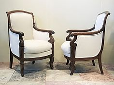 pair of french empire mahogany bergere armchairs