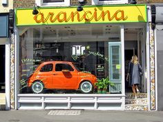 Fiat 500 with Pizza. 'Arancina'. Sicilian restaurant. Pembridge, Road London.
