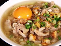 Batchoy - is a noodle soup garnished with Pork innards, crushed Pork cracklings, vegetables, and topped with cracked raw egg; a truly tempting treat.