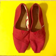 TOMS 8 Red Canvas Flats A cute basic pair of red flats. Perfect as a statement color in your outfit, works with jeans or a dress or even shorts! TOMS Shoes Flats & Loafers
