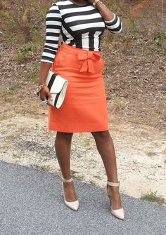 Orange is the New Black! Throw on a skirt over an old dress for a new look!