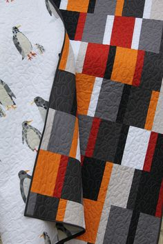 Modern quilts are not usually my favorite...but the penguin backing could change my mind...a pretty straightforward modern top with an awesome touch of whimsy for the back.  Balance!