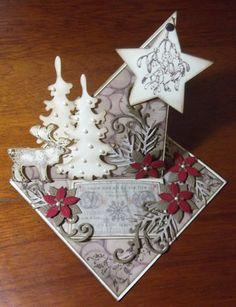 a twisted easel card with die cut pieces and papers from Marianne Design (plus…