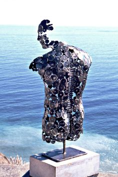 """""""Reflection"""" (self portrait; 2008), by Stephen Fitz-Gerald. Recycled scrap steel punch parts."""