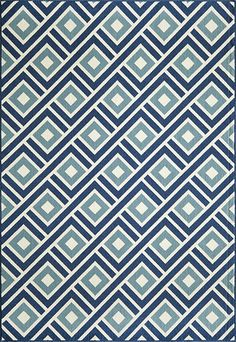 An exciting color palette with a gorgeous geometric pattern makes this indoor/outdoor rug great for any patio or living area! Available now at Rug & Home! #geometric #blue