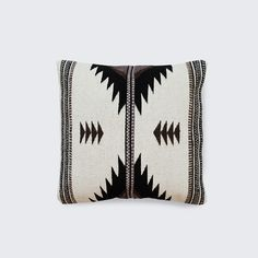 Handwoven in Mexicoby The Women of Oaxaca Inspired by the geometric patterns used by the Zapotec tribes of the Oaxaca region, this lumbar pillow's structural