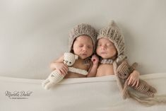 Atlanta newborn photography- twin girls photographed with stuffed animal with neutral colors