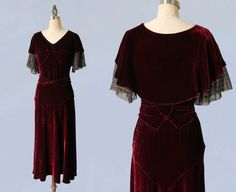 Luxurious burgundy liquid silk velvet gown. Flattering old Hollywood silhouette, with dramatic capelet collar, deco seaming around the bust,