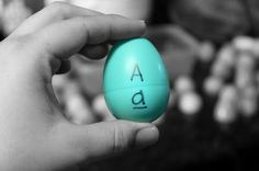learning upper case and lower case letters by matching with plastic eggs.