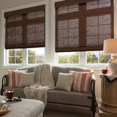 Good Housekeeping Woven Wood Shades by SelectBlinds.com are the perfect window covering for a cozy living room.