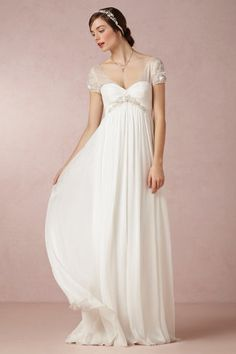 Elisa Gown- Romance meets timeless elegance in this cap sleeved gown from Badgley Mischka. Accented with delicate embroidery, beads, and blooms, this silk chiffon beauty creates an ethereal silhouette for all figures. Silk chiffon