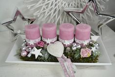 I offer you a nice arrangement on a wooden tray in . Offer you a nice arrangement on a wooden tray in pink. A wooden tray in country st Rose Gold Christmas Decorations, Christmas Advent Wreath, Xmas Wreaths, New Years Decorations, Christmas Crafts, Diy Candles Ingredients, Christmas Candle Holders, Pink Candles, Motif Floral