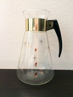 Your homemade cold brew coffee will look amazing in this eclectic coffee pot! - Retro Atomic Starburst Coffee Carafe by Pyrex Corningware