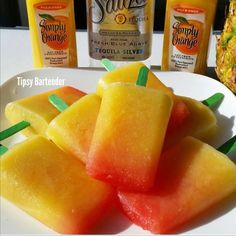 Tequila Sunrise Popsicles - For more delicious recipes and drinks, visit us here: www.tipsybartender.com