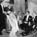 Brian Aherne, Joan Crawford, director W.S. Van Dyke, Fred Keating and Frank Morgan between shots of I Live My Life