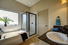 The master bathroom features a dual granite vanity, walk-in closet with built-in shelving, jetted tub, and a separate shower with glass enclosure.