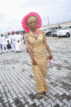 Nigerian Aso Ebi Style, Gold/Pink lace dress, Gele and jewelry. #Africanfashion #AfricanWeddings #Africanprints #Ethnicprints #Africanwomen #africanTradition #AfricanArt #AfricanStyle #Kitenge #AfricanBeads #Gele #Kente #Ankara #Nigerianfashion #Ghanaianfashion #Kenyanfashion #Burundifashion #senegalesefashion #Swahilifashion ~DK