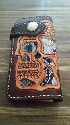 Handmade carved biker wallet €85,00