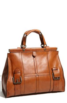This would be a good gift from a sibling. Larger office style purse. Brown black or blue