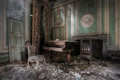 Faded grandeur: Dutch photographer Niki Feijen specialises in urban exploration; capturing the abandoned and decaying buildings that lie behind 'do not enter' signs  Read more: http://www.dailymail.co.uk/news/article-2316987/Photographer-Niki-Feijens-eerie-images-abandoned-farm-houses.html#ixzz2hucqoQvg  Follow us: @MailOnline on Twitter | DailyMail on Facebook