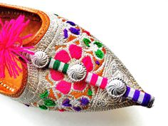 I need to find things like this next trip to India! I don't wear them, I use them as home décor.    Vintage Embroidered Pointed Toe Indian Shoes/ by Nuvegriz