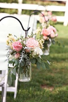 These filled jam jars are so pretty hanging down the isle