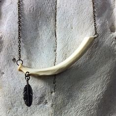 SALE LAST ONE - Rib Bone Necklace with Feather Charm on by BoneLust