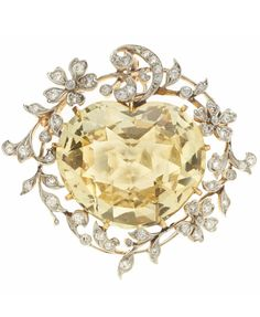 A Belle Époque yellow sapphire and diamond brooch-pendant, J.E. Caldwell & Co., circa 1900 heart-shaped mixed-cut sapphire measuring approximately 23.5 x 20.9 x 11.3mm; signed J.E.C. & Co., ref. no. D7551; estimated total diamond weight: 1.20 carats; mounted in platinum-topped 18k gold; length: 1 1/2in.