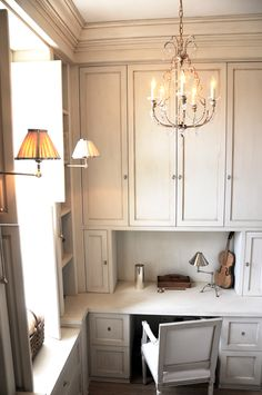 sweet kitchen office space. Great idea with the chandelier lighting. leo designs chicago | swedish gallery