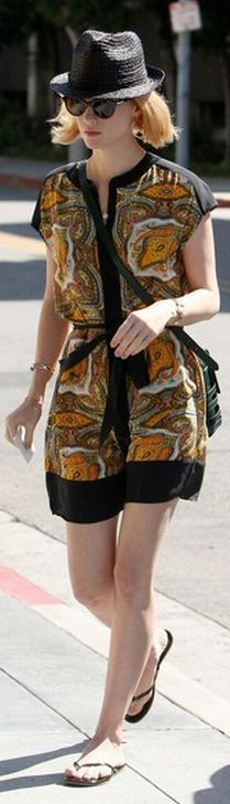 Who made  January Jones' yellow print dress and black flip flops that she wore in West Hollywood?