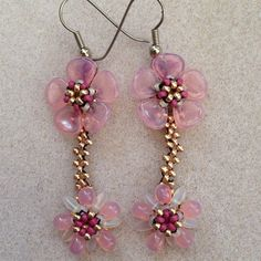 Handmade earrings using petal beads, drop beads and seed beads in right angle stitch.