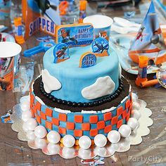 Airstrip, puffy clouds & Planes candles featuring Dusty and more--what more could a birthday pilot ask for? Click for our High-Flying Planes cake how-to!