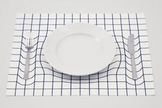 trick mat by A.P.WORKS  It looks like the cutlery and the plate is sinking into the mat :)
