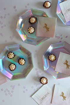 Iridescent plates and unicorn napkins - the perfect foundations for a unicorn party!