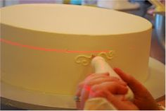 Use a Laser Level to help keep your decorating straight! via Cup a Dee Cakes Blog