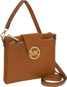 We love the Large Fulton Cross-Body by MICHAEL Michael Kors! Shiny gold-tone hardware compliments the pebbled luggage leather exterior. As versatile as it is stylish, the adjustable buckled cross-body strap makes this bag perfect for a girl on the go! The MK circle logo on snap-flap detail opens to show two zip top pockets divided by a center snap pocket with six card slots and a currency pocket. The interior is lined with tone on tone MK logo printed fabric, trimmed in the same luggage…