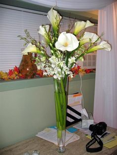 calla lillies with other flowers