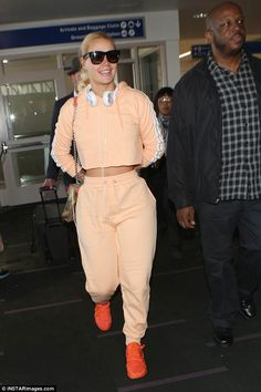 Top of the crops! Iggy Azalea flashes her midriff as she signs autographs and poses with f...