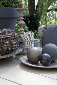Outdoor and backyard decoration craft: Spray paint centerpiece orbs.