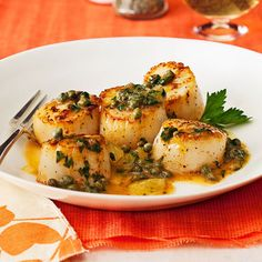 Daily Bite: Impress guests with this elegant and fast  Lemon Caper Scallop supper. Top em off with briny capers for added flavor and contrast. Plus its gluten-free!