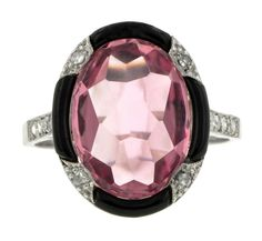 Edwardian platinum ring with a centre pink tourmaline surrounded by diamonds and black enamelling, circa 1915. Available from Doyle & Doyle ($5,200).