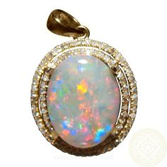 Opal Pendant with Diamonds in 14k Gold.  A 5.25 Carat Coober Pedy Light / White Opal oval in shape with Red and Blue colors and surrounded by two rows of diamonds.  Ready to ship in Yellow Gold or can be made in White or Rose Gold.  Or the opal can be set into a different pendant or ring setting.
