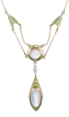 Art Nouveau Enamel Moonstone Necklace    14k yellow gold, with a 1.75 inch drop. Soft peridot green and off-white enamel is complimented by blue flash monotone and a pearl.  Circa 1915.