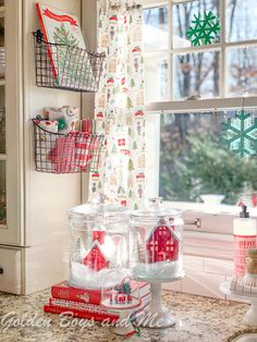 Christmas kitchen with wire storage baskets and village in glass jars - www.goldenboysandme.com Christmas Bathroom Decor, Christmas Room, Christmas Kitchen, Merry Little Christmas, Cozy Christmas, Rustic Christmas, Christmas Lights, Vintage Christmas, Christmas Ideas