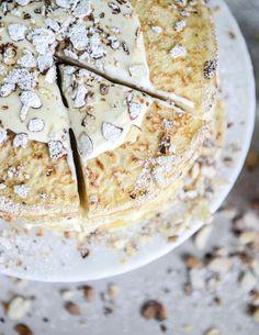 almond cream crepe cake  // eggs, milk, flour, butter, vanilla, sliced, powdered sugar, half and half, almond paste, sugar, salt, cornstarch, egg yolks, almond extract, heavy cream