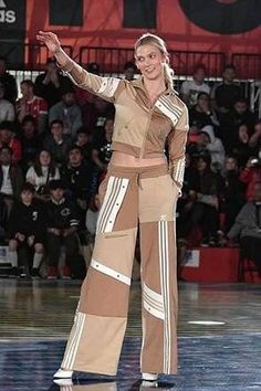 Karlie Kloss wearing Adidas Originals X Danielle Cathari Deconstructed Track Pants in Linen Khaki, Adidas Originals X Danielle Cathari Deconstructed Track Jacket in Linen Khaki and Christian Louboutin So Kate White Aurora Boreale Pumps