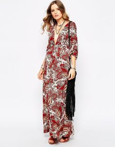 "Maxi dress by First & I Lightweight, woven fabric Plunge v-neckline Wide-cut cropped sleeves Regular fit - true to size Machine wash 100% Polyester Our model wears a UK S/EU S/US XS and is 176cm/5'9.5"" tall"