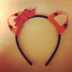 Daniel Tiger ears I made for my daughters 2nd birthday party themed Daniel Tigers Neighborhood. Items needed; Thicker headband, orange and tan felt, ribbon, sharpie, fabric glue or hot glue