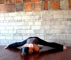 To stretch your hips, hamstrings, and inner thighs, do a Wide-Legged Split. From Wide Squat, place your hands on the floor in front of you and inch your feet apart, making sure to keep your heels wider than your toes. Keep the soles of your feet flat on the ground at all times to protect your knees. As your hips get lower, you can prop yourself up with your forearms, and then move down to your shoulders (as shown). If your shoulders are on the ground, turn your head to the ...