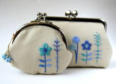 Embroidered blue flower pouches by oktak_ny, via Flickr